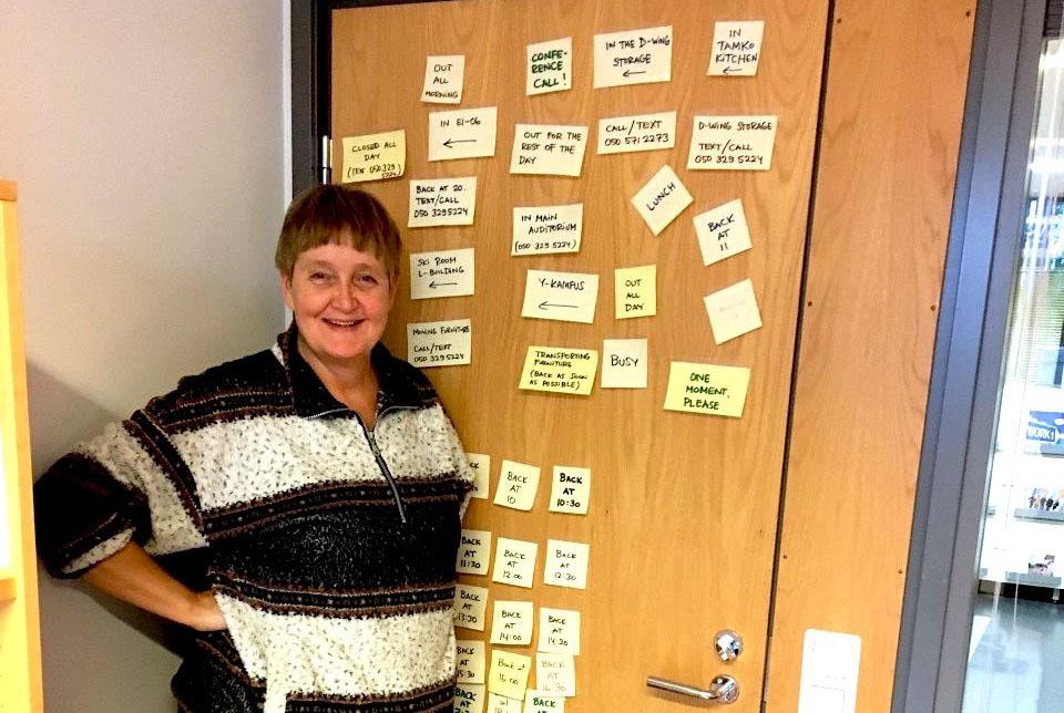 TAMK's social counsellor Mirja standing next to her office door