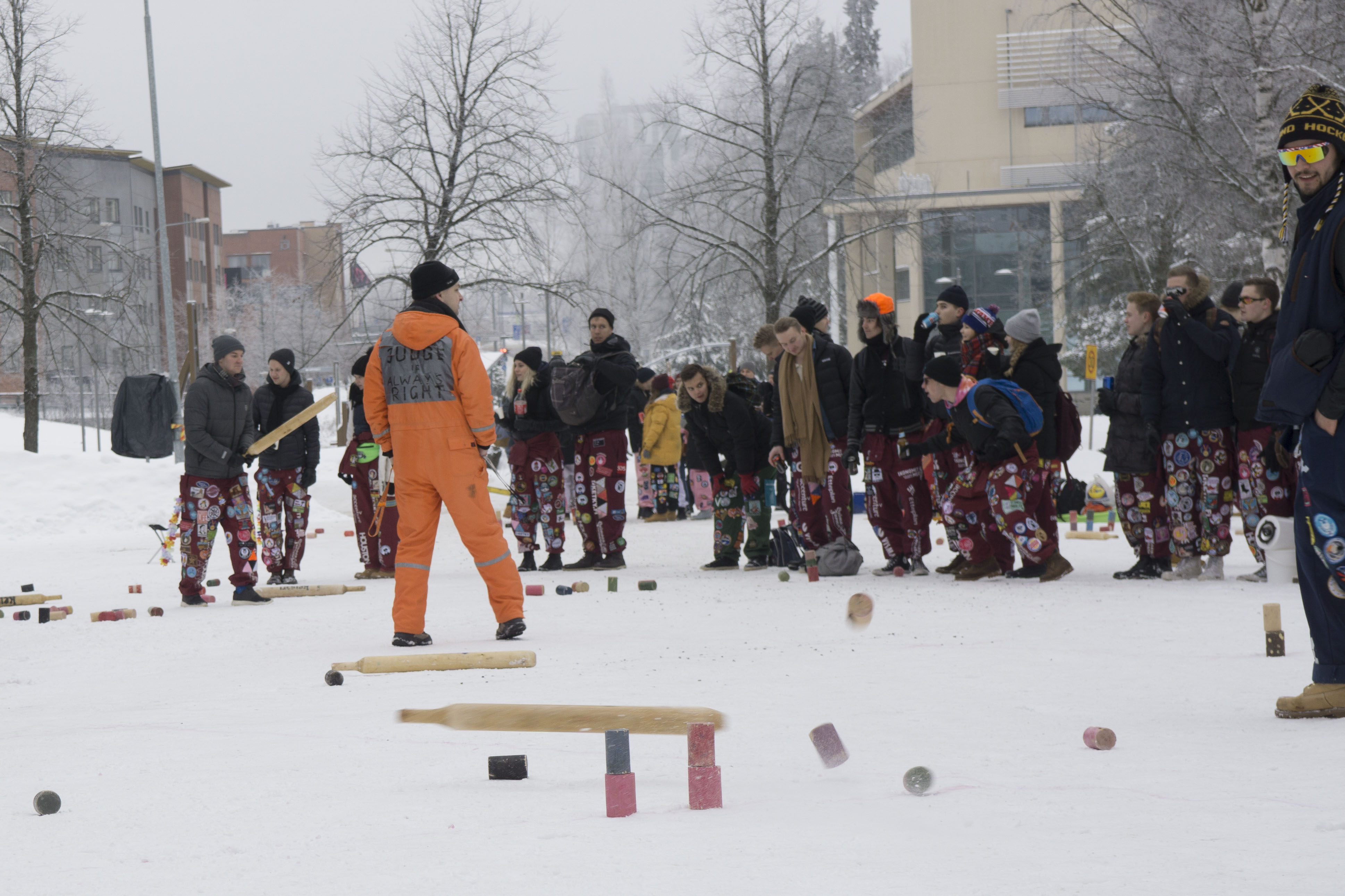 Students playing kyykkä.