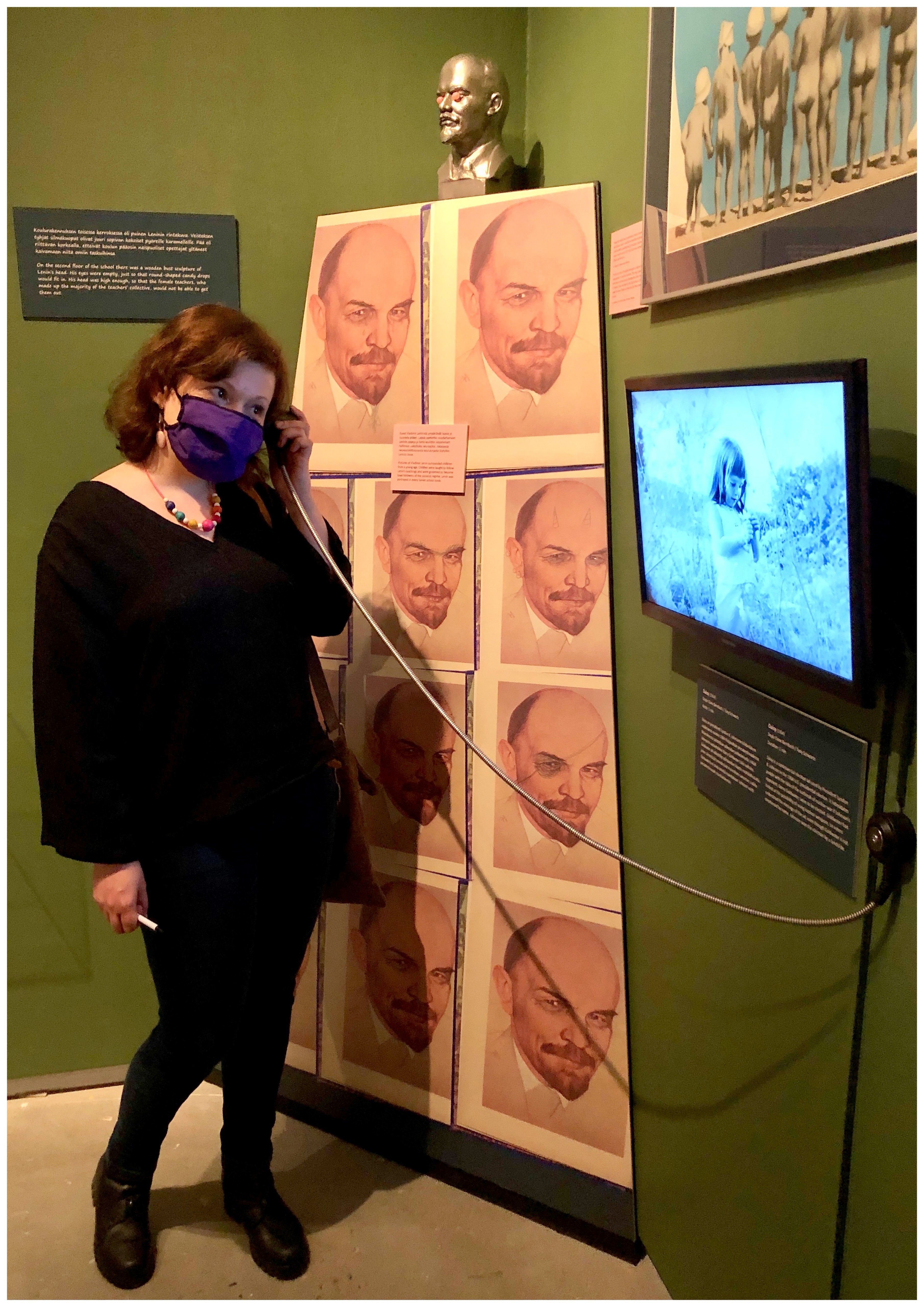 A person trying out an old telephone in the exhibition.