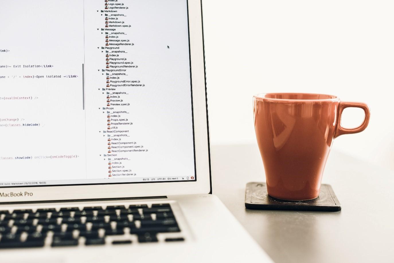 A laptop and a mug.